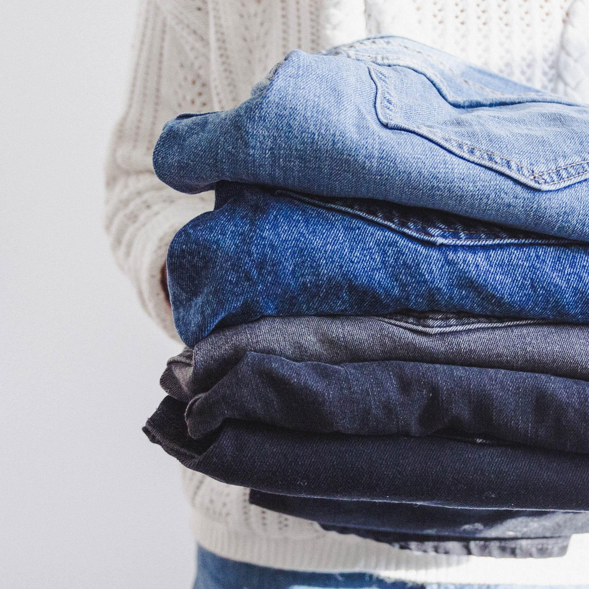 Clothing donation, pile of jeans in