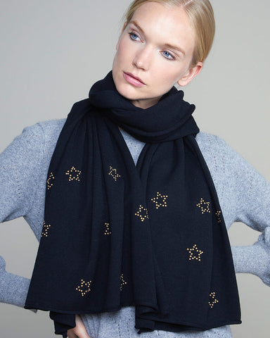 model wearing a black scarf with gold studded stars