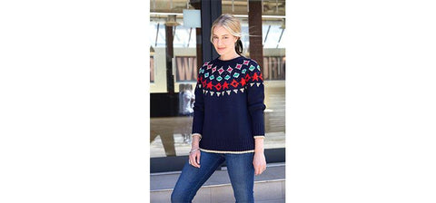 An influencer wearing the Holly Fairisle jumper