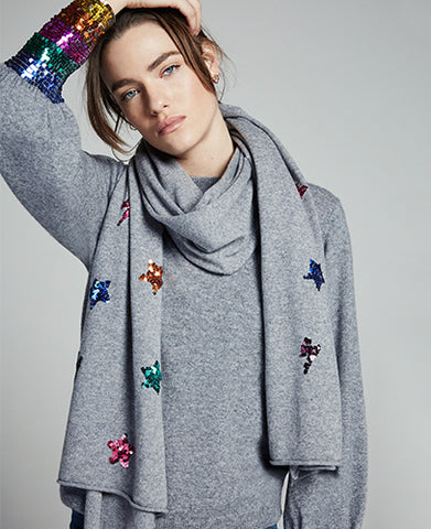 model wearing a grey scarf with sequin stars