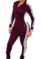 3 Stripe Trendy one piece warmup suit.