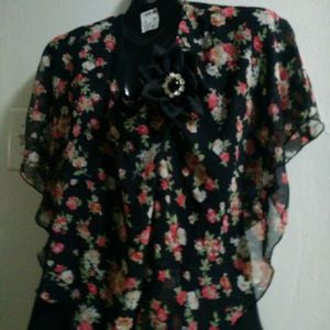 Black blouse w flower deco and pendant broach...