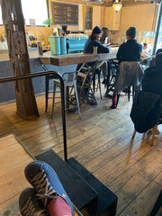 SOM shoes traveling and sipping café in Paris