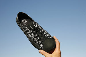 SOM minimalist footwear black shoe with bicycle pattern on blue sky