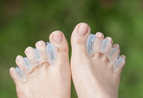 Correct bunions, hallux limitus and rigidus, tailor's bunions, corns, ingrown toenails, heel pain, plantar fasciosis, neuromas, capsulitis, lower leg pain, and runner's knee naturally with Correct Toes Toe Spacers.