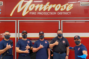 Montrose firefigthers wearing face-mask made by SOM footwear