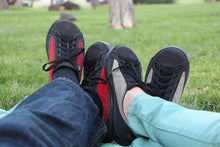 Norwood Red and Sage by SOM Footwear, sitting in a park on green grass background