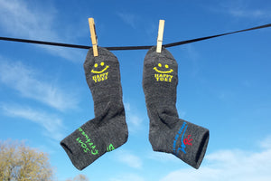 Merino Wool Colorado Made Socks with Happy Toes Smile hanging on clothesline