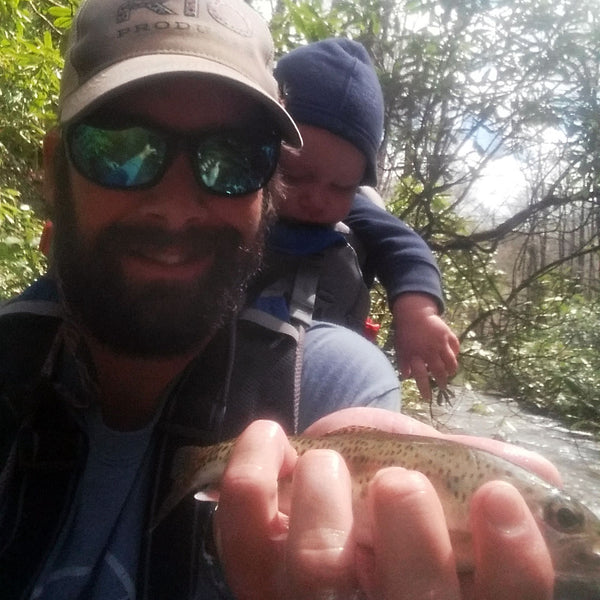 Ryan Kaufman, fly fishing guide Headwaters Outfitters with child