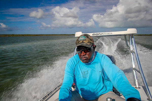 Simeon Higgs from East End Lodge races to the bonefish and permit flats.