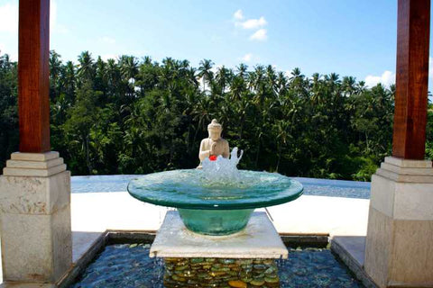 Buddha statue at the Viceroy in Ubud Bali by Kate Stoltz