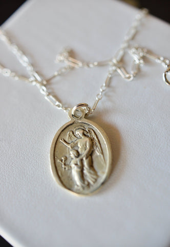 Saint of travels, initial and Zodiac medallion