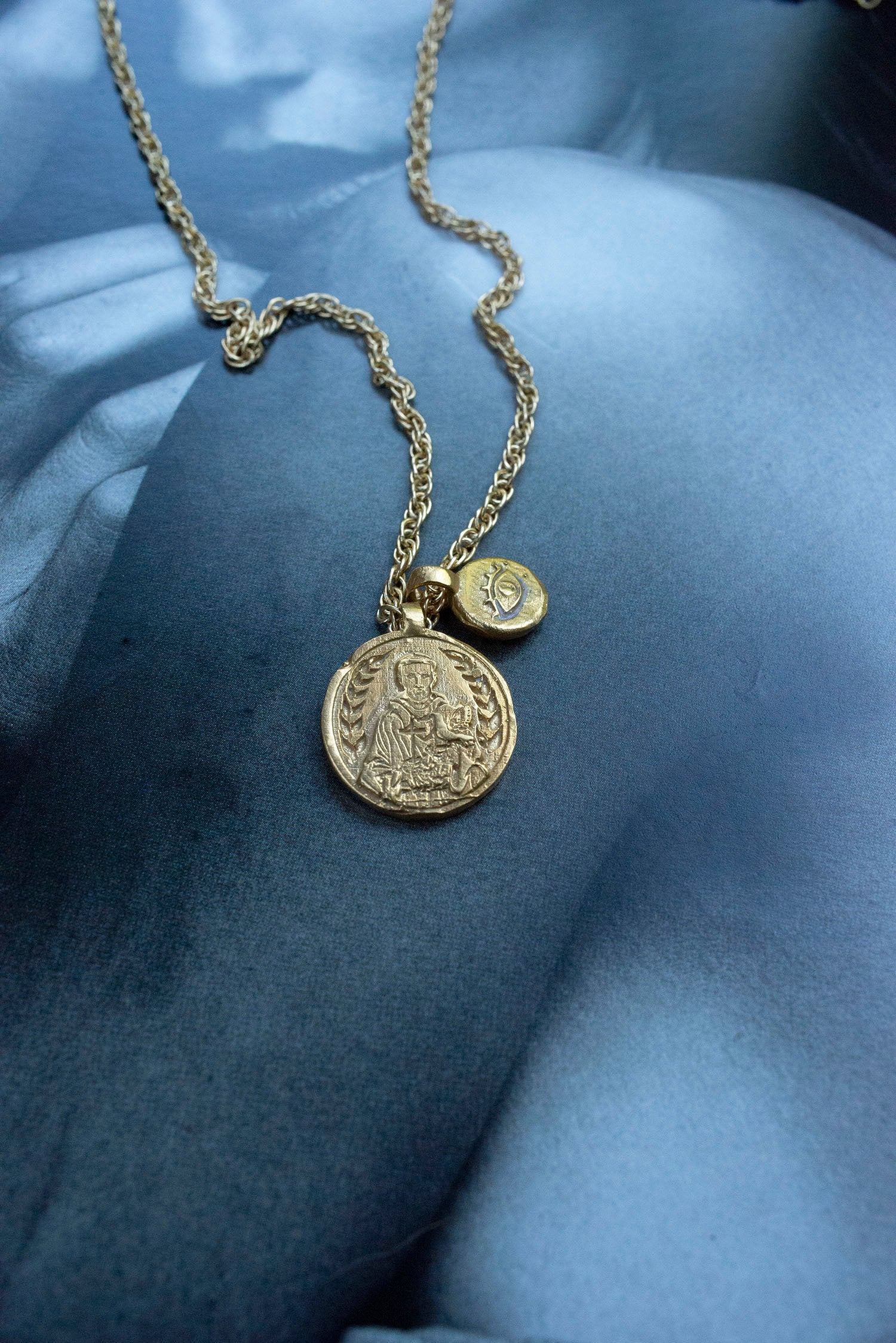 St. Francis & Eye coin rope necklace