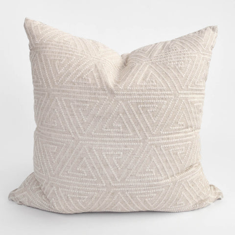 Embroidered beige pillow