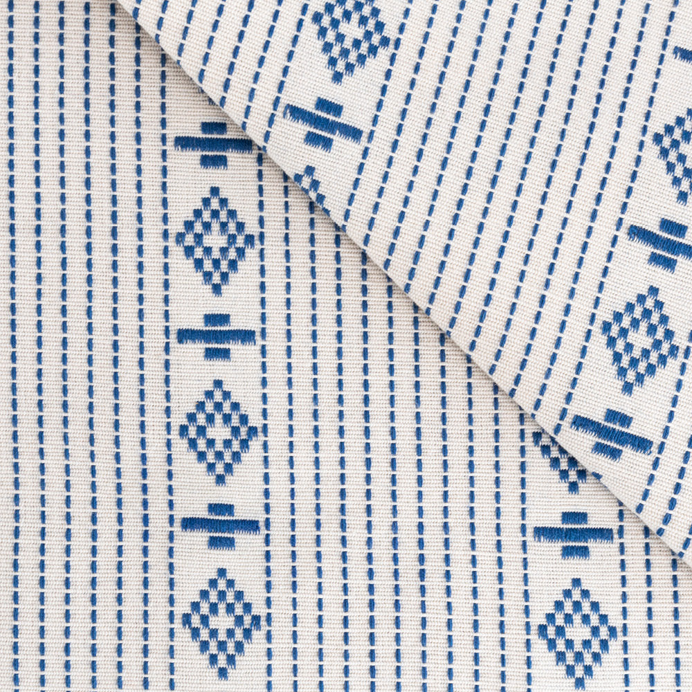 Audrey, a blue on ivory motif stripe cotton fabric from Tonic Living