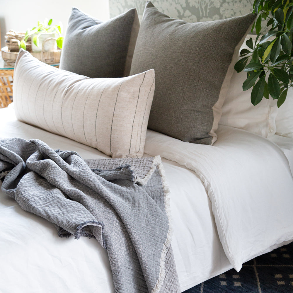 Kenmare bed pillows on bed with Dunrobin bolster