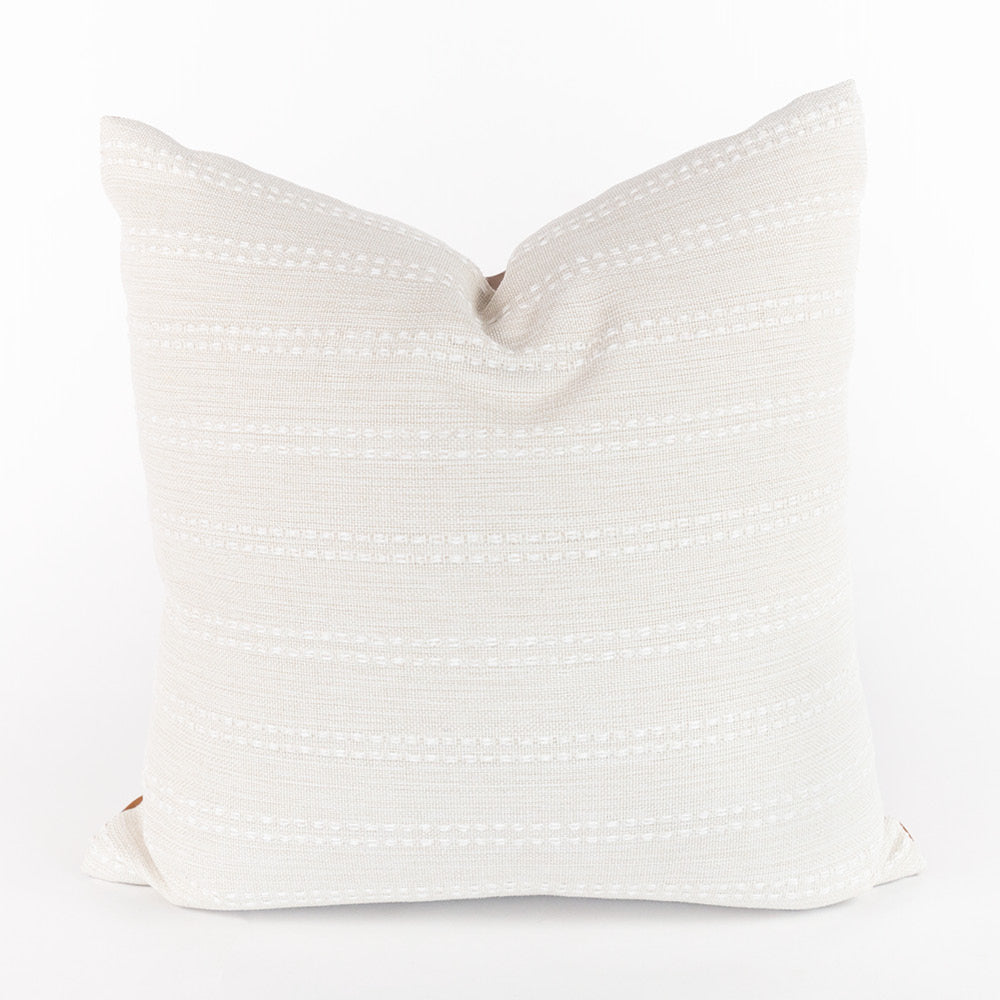 Dani Pillow, a creamy white front and saddle brown faux leather back pillow from Tonic Living