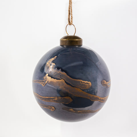 Horizon holiday ornament, a metallic blue and gold coloured glass ornament from Tonic Living