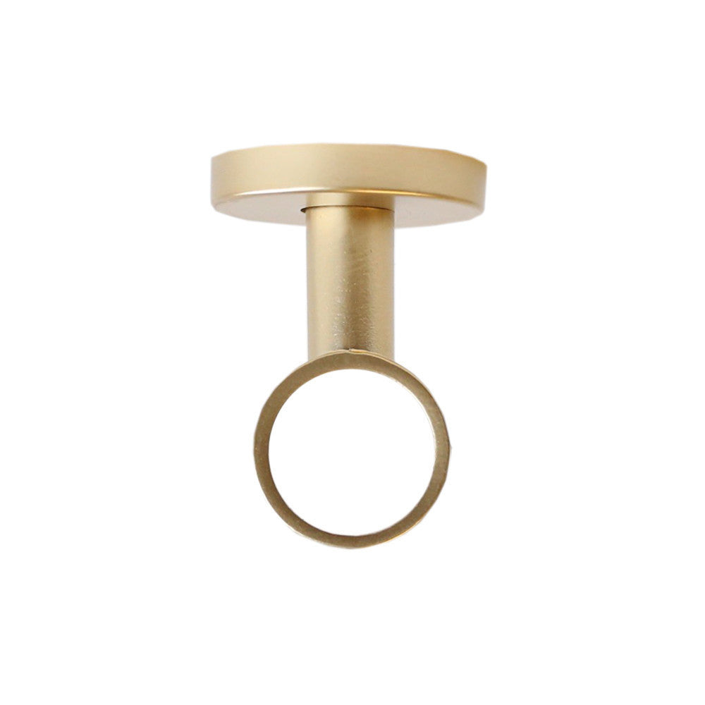 Matte gold ceiling bracket drapery hardware from Tonic Living