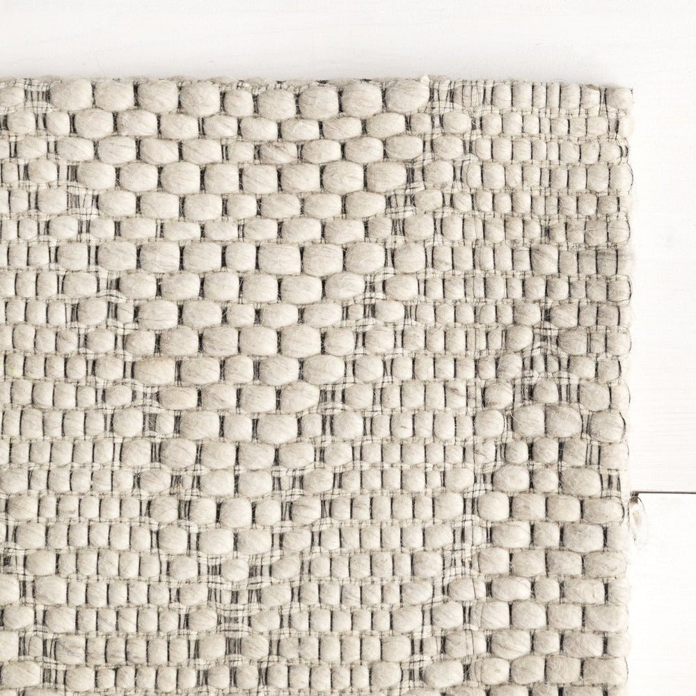 Kakisa ivory textured wool rug at Tonic Living
