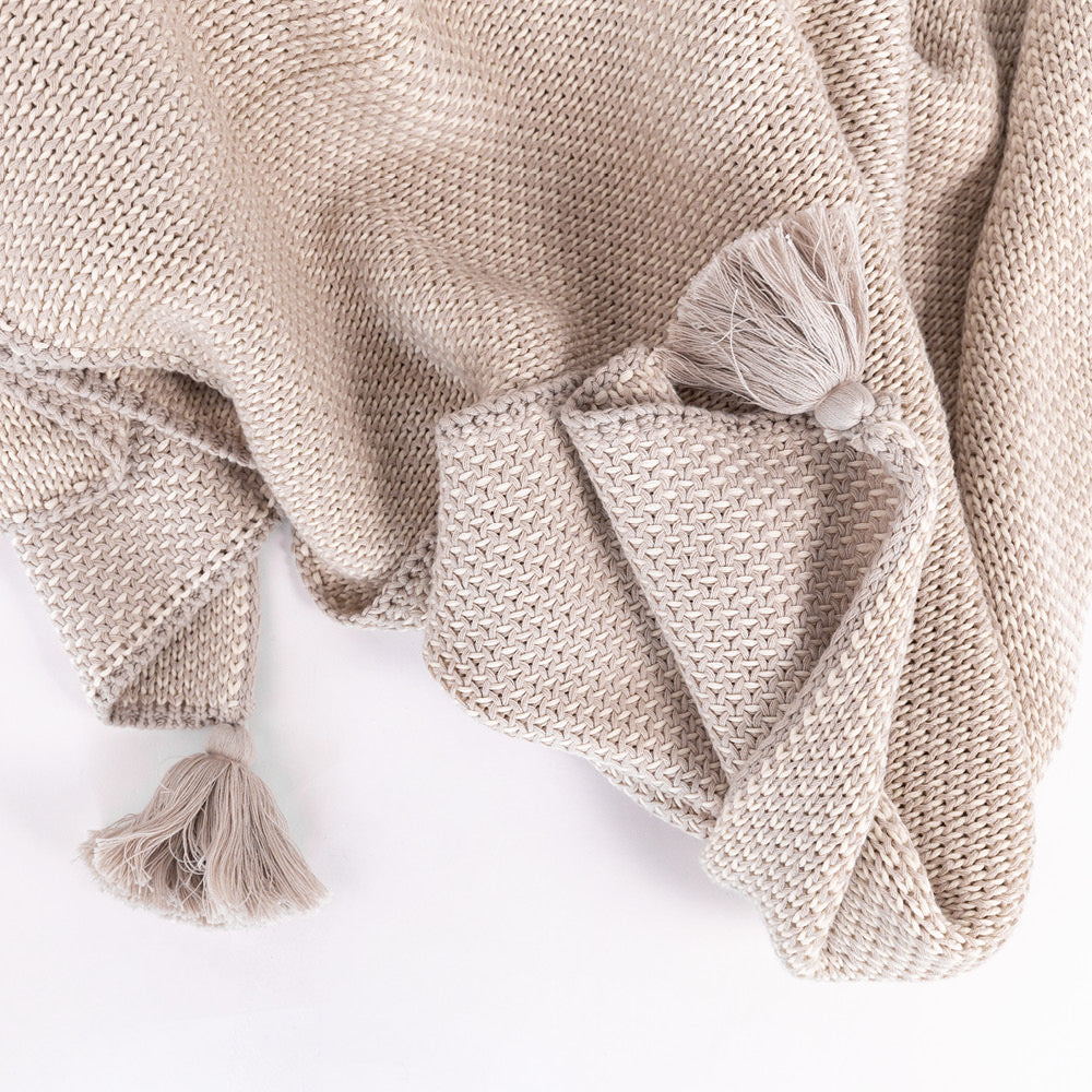 Lottie Tassel Throw, Sand, a beige sweater knit blanket with tassels from Tonic Living