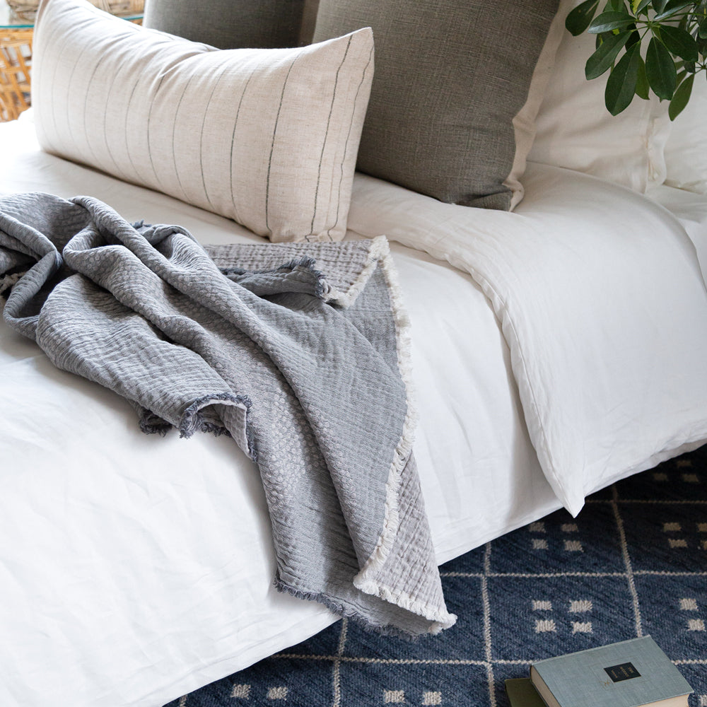 Grey Mira linen-cotton throw on bed