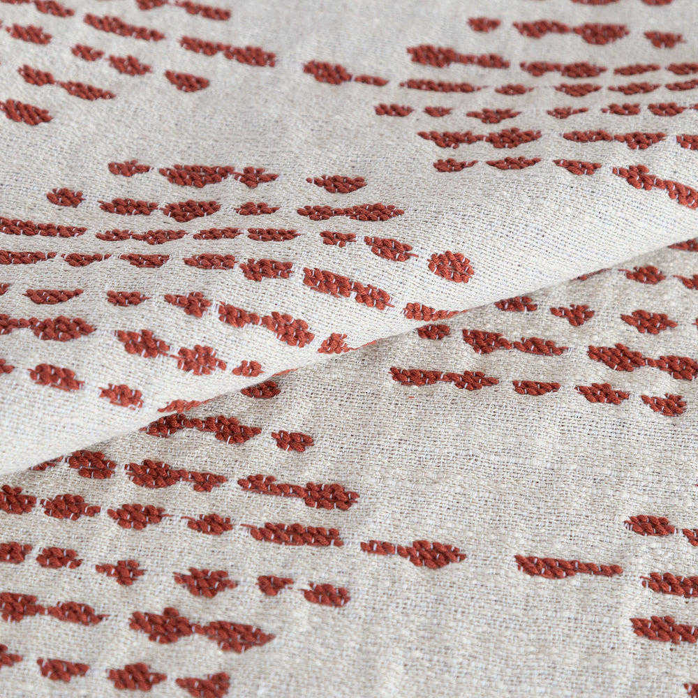 Ophelia Rust, a brick red on cream dash dot outdoor fabric from Tonic Living