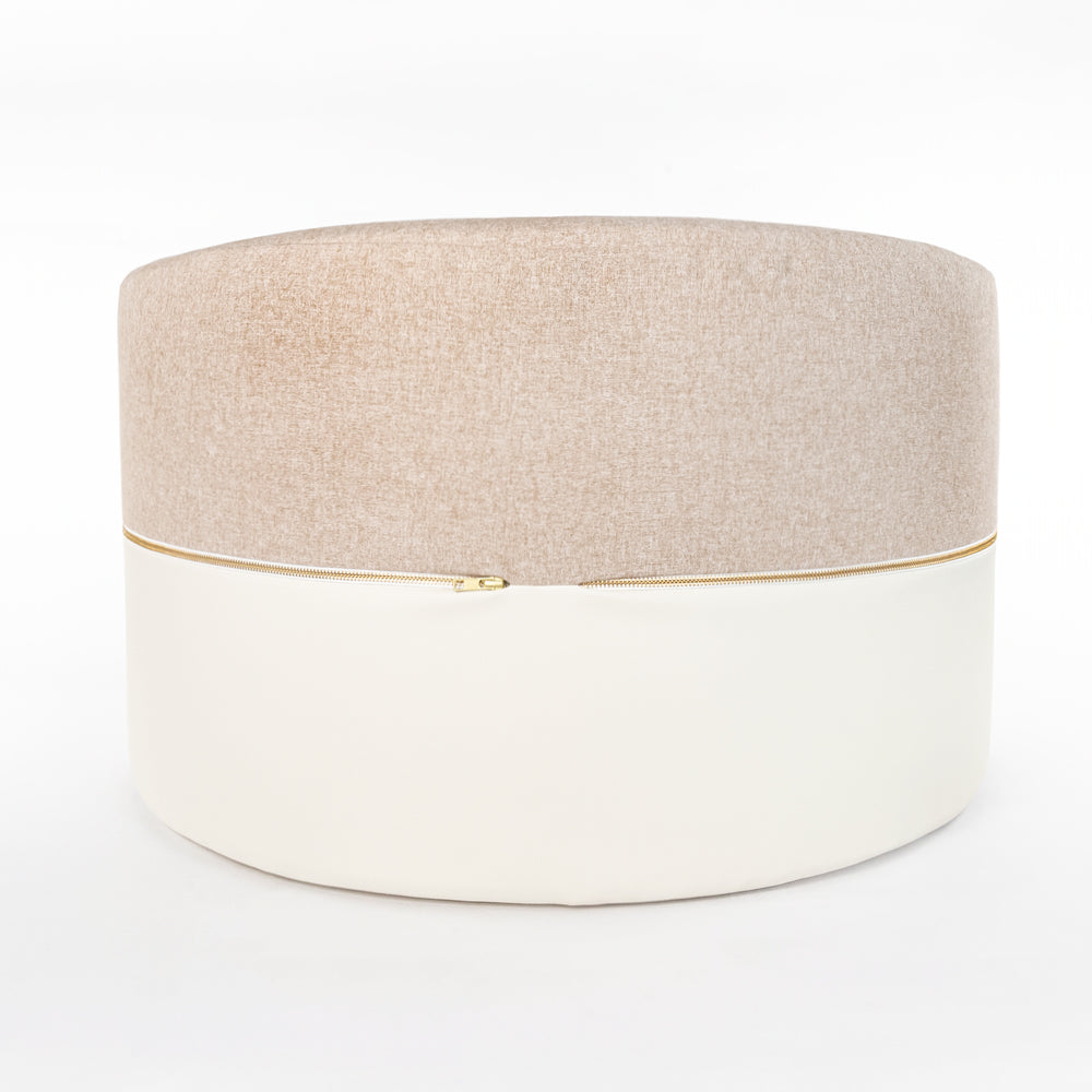 Willow, a beige felt and cream faux leather, large round ottoman from Tonic Living
