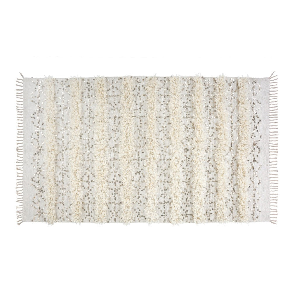 Konya - Tonic Living, This oatmeal and cream rug inspired by traditional Moroccan wedding blankets is a gorgeous addition to any room needing a little oomph.