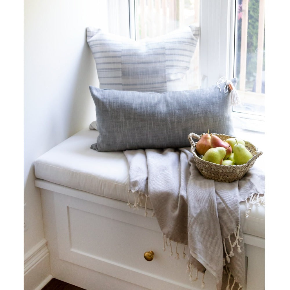 Tonic Living pillows on a light filled window seat