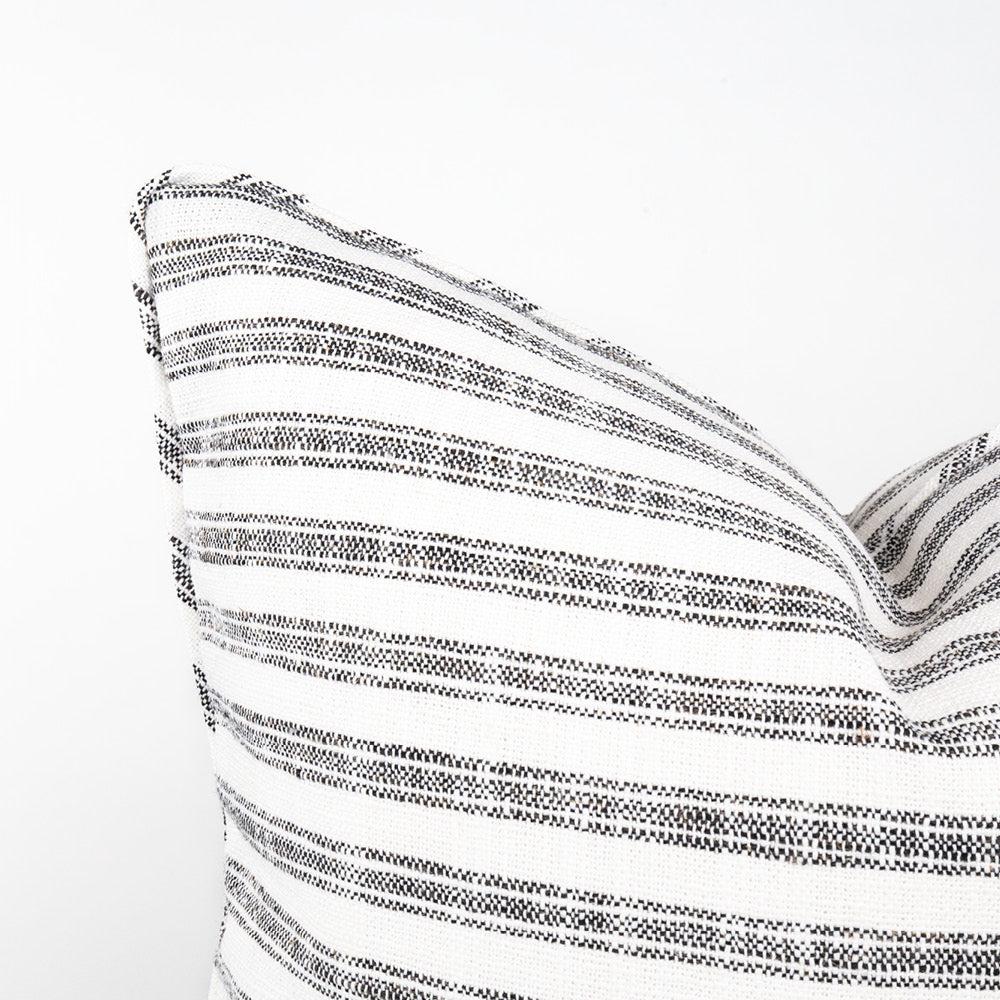 Thompson Ticking Domino, a black and white stripe stain resistant piped pillow from Tonic Living