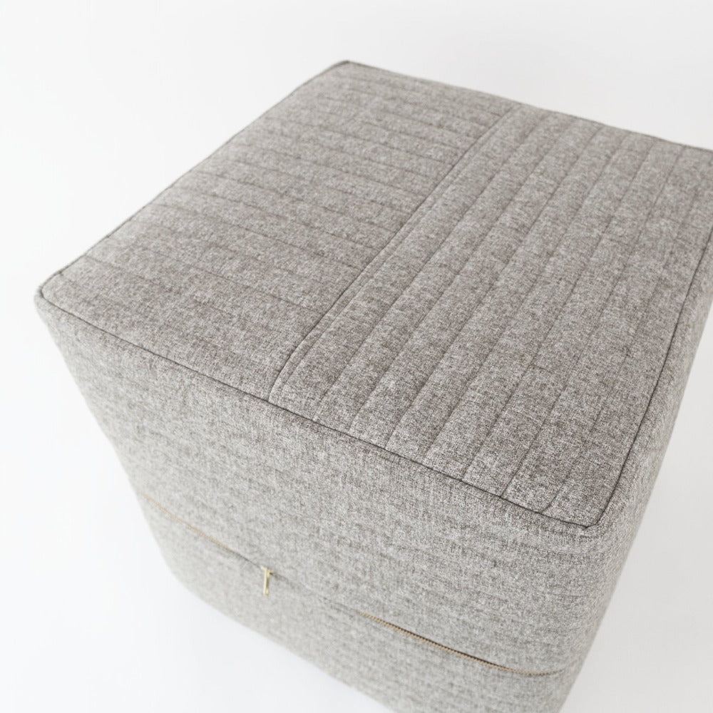Tobermory Quilted Felt Ottoman Cube, Flannel, a grey channel quilt felt ottoman from Tonic Living