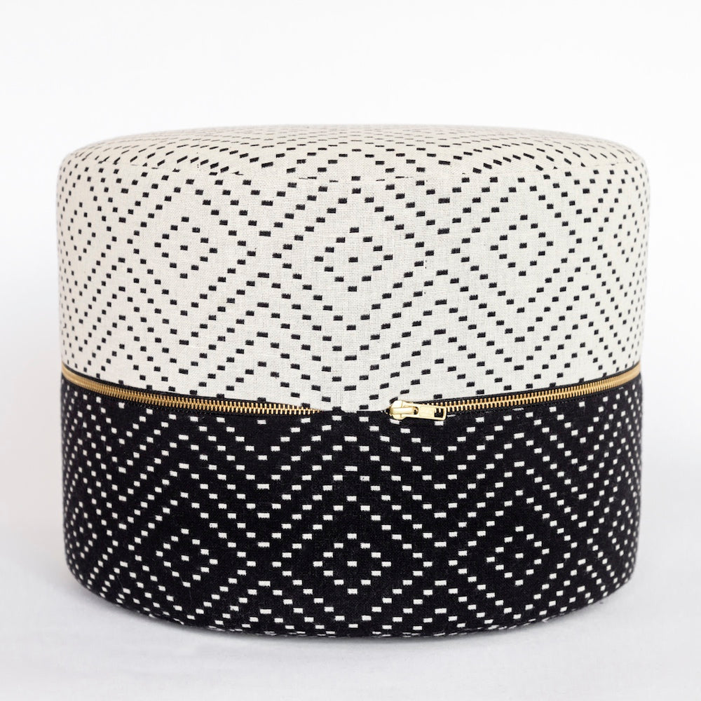Ava, a black and white diamond pattern mini round ottoman from Tonic Living