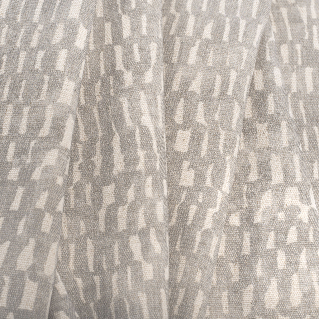 Avareno Silver, a light grey and sandy beige small scale abstract print fabric : close up