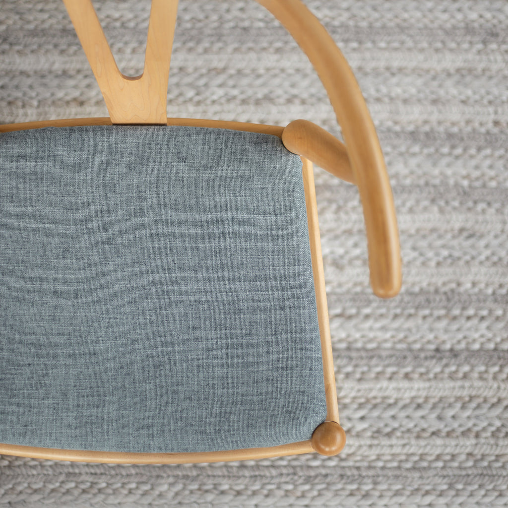 Benton chambray blue upholstered seat on a dining chair