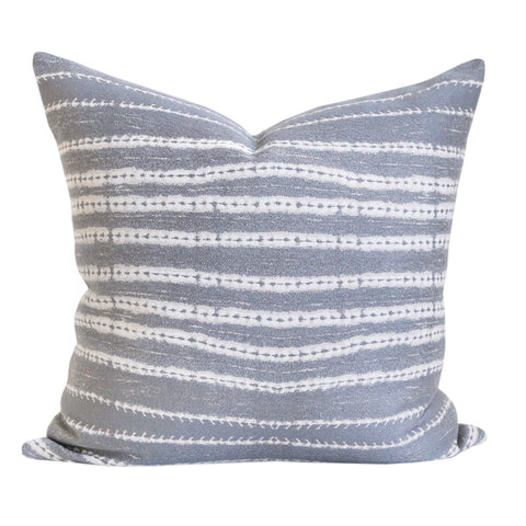 A stone grey, sand and white organic striped pillow in a durable fabric.