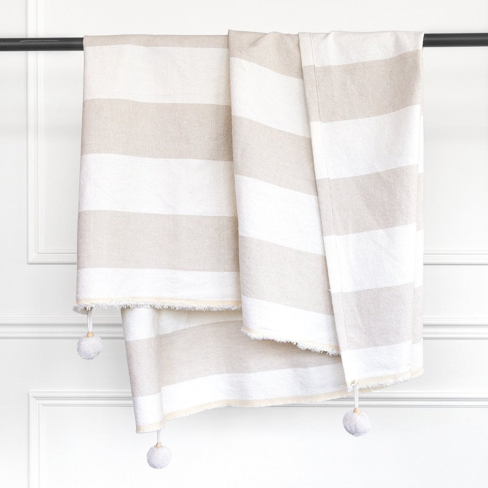Charlie beige and white stripe linen pompom throw from Tonic Living