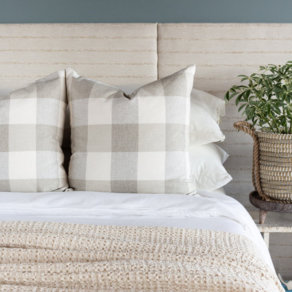 Neutral Bed pillow combination: Cottage Check cream and taupe buffalo check pillows and Handlavet beige stripe fabric headboard