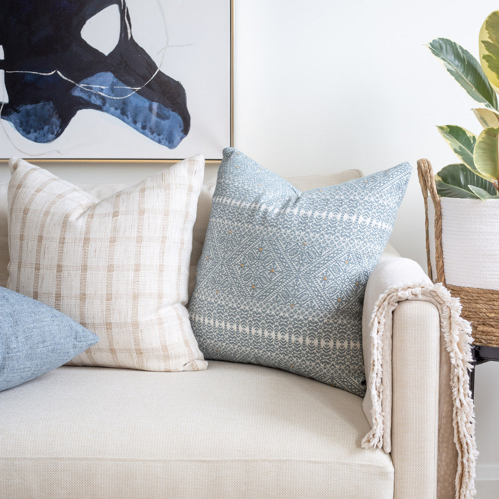 Cream sofa pillow combination: Delilah blue and white lace pattern pillow with Harriet Check ivory and beige pillow