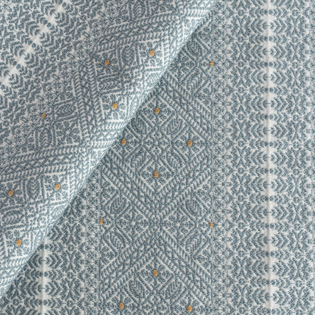Delilah Stone Blue Fabric, a soft blue and white intricate pattern home decor fabric from Tonic Living