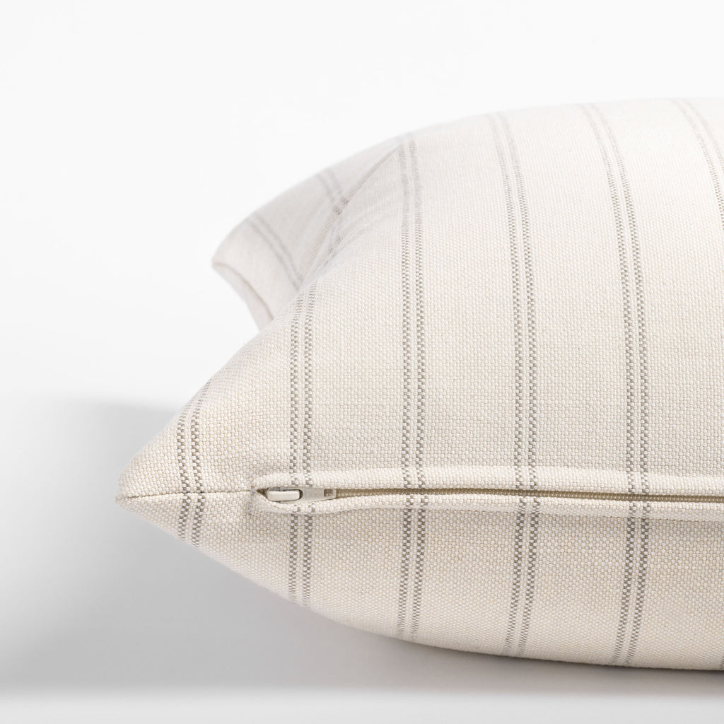 Farina 20x20 Pillow Birch, a cream and warm gray vertical striped pillow : close up zipper view