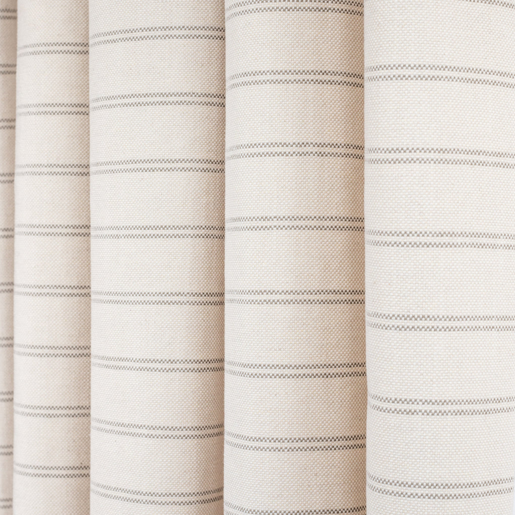 Farina Stripe Birch, a light beige with a warm grey horizontal stripe home decor fabric