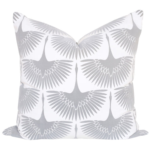 "A graphic bird pillow in a dove grey and white. Black birds have a ""flocked"" finish which is a short, textured velvet feeling.  Made in Canada. 22"" x 22"""