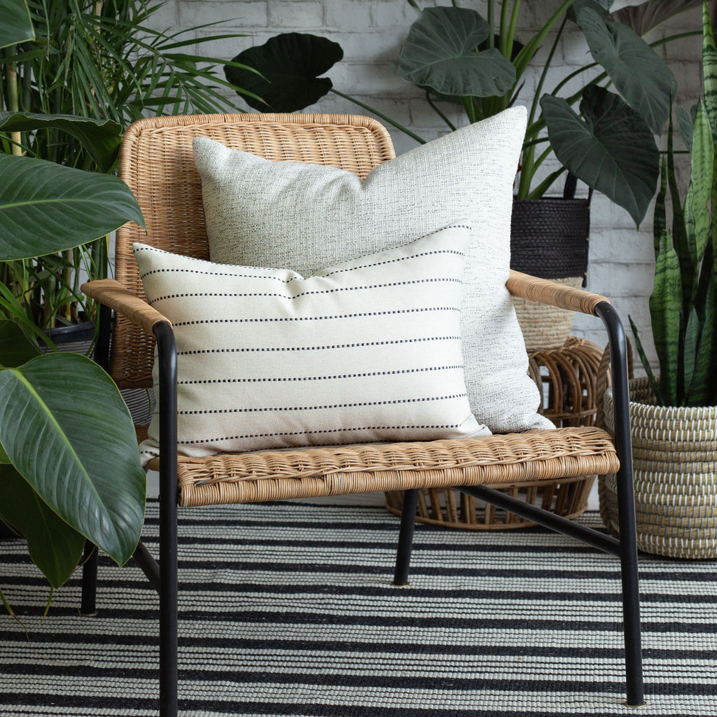 Outdoor Vignette: neutral indoor outdoor pillows and plant baskets from Tonic Living