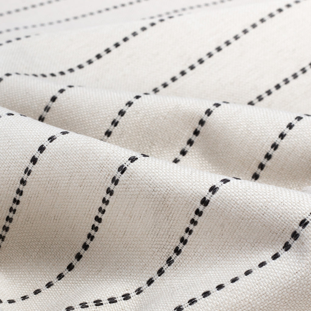 Fontana Graphite, a cream and black stripe indoor outdoor fabric : close up view