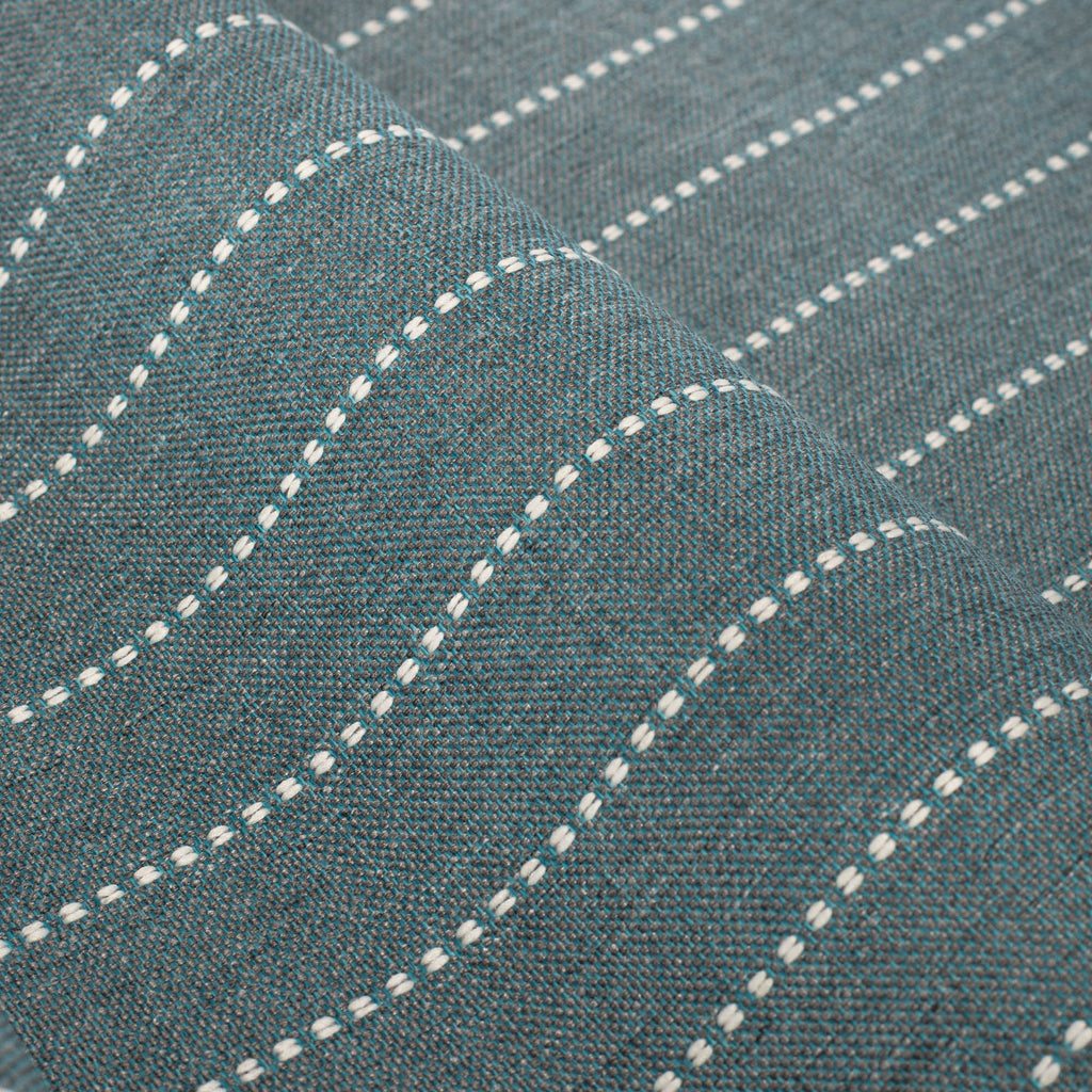 Fontana Water, a teal blue and white horizontal stripe indoor outdoor fabric : close up view