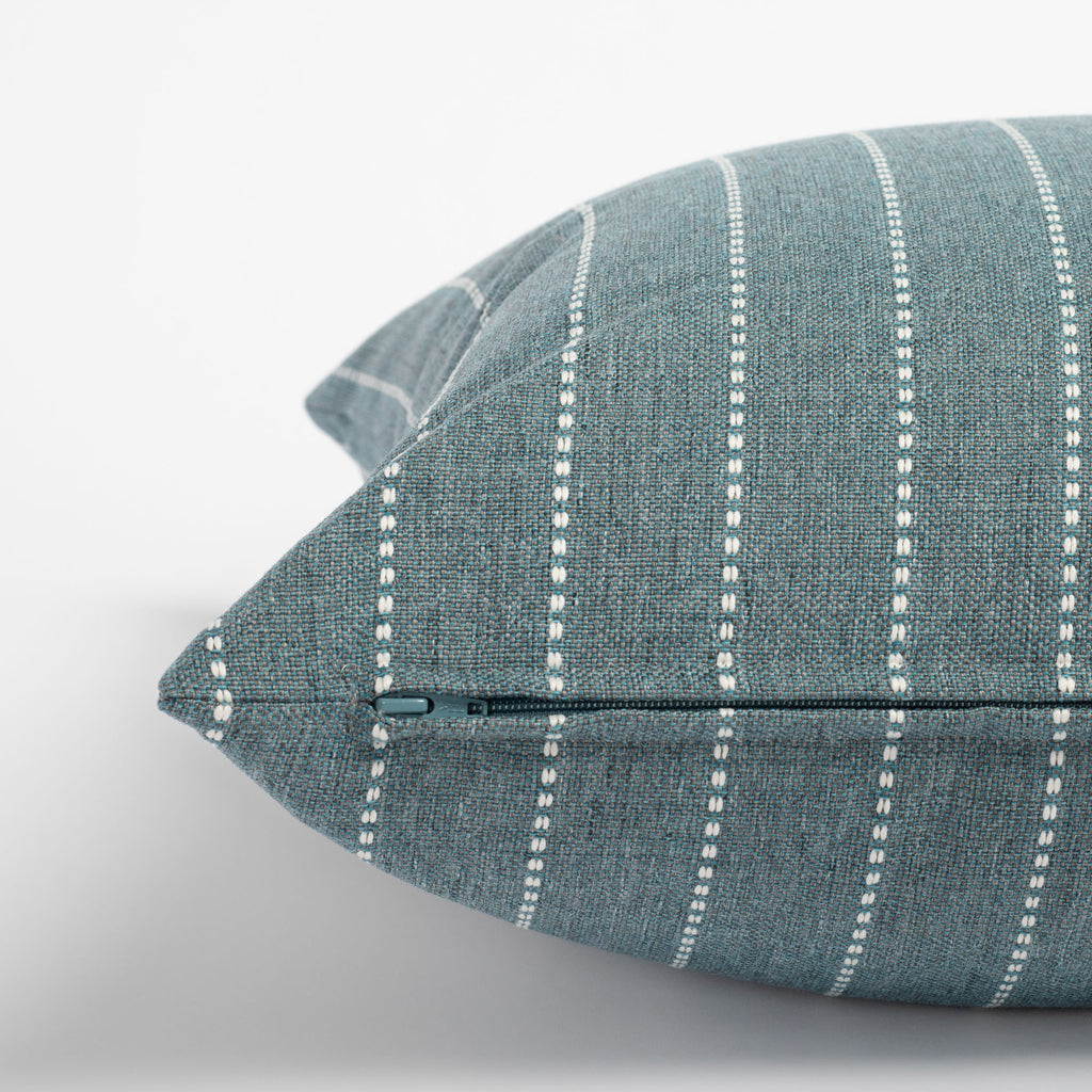 Fontana Water 20x20 pillow, a teal and white vertical stripe indoor outdoor pillow : close up zipper detail