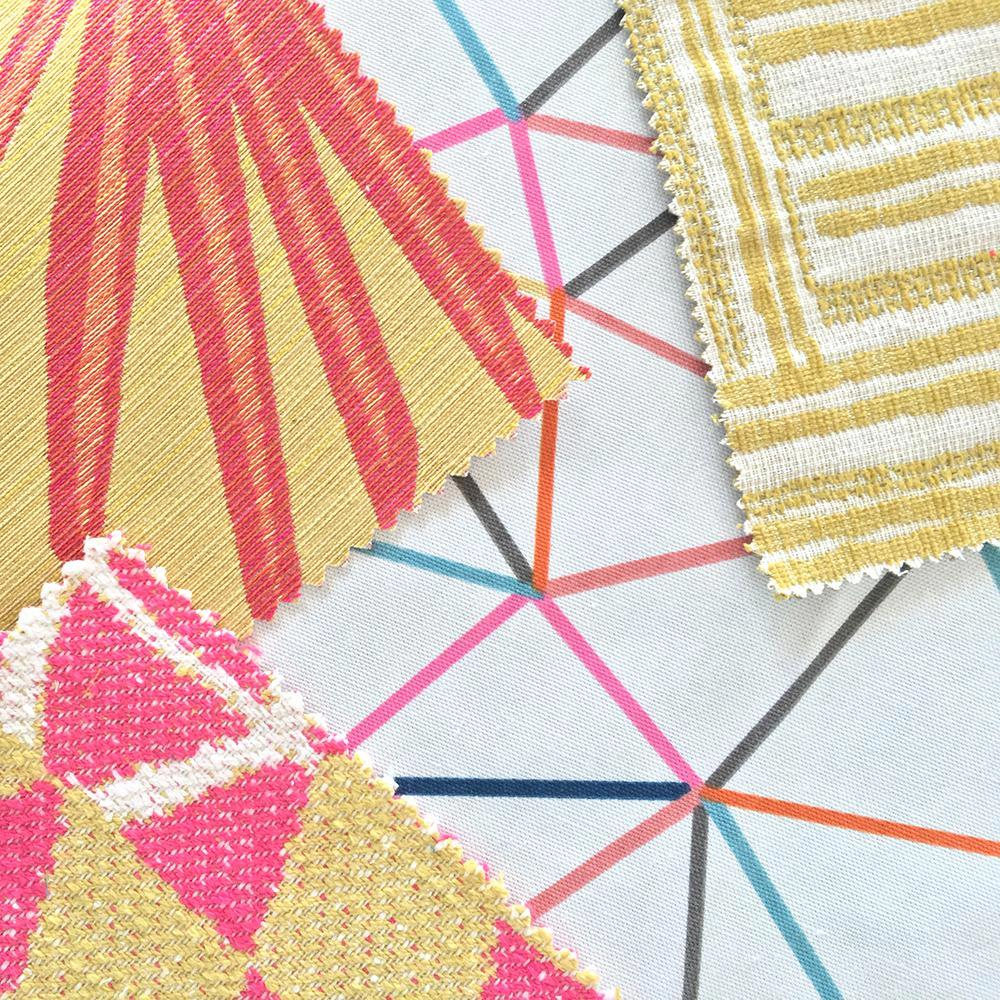 A yellow and hot pink small scale geometric with a global punch, from the Justina Blakeney Home collection.