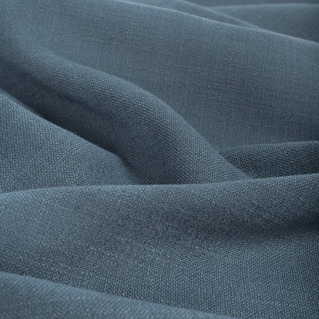Grange Fabric Storm Blue, a high performance denim blue upholstery fabric with a subtle textural weave from Tonic Living