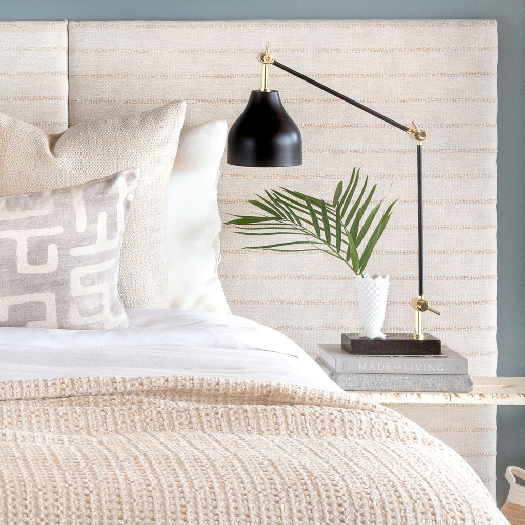 Neutral bed vignette: Handlavet Stripe raffia fabric headboard with Karru silver bed bolster and Milly cream pillows and Lena throw blanket